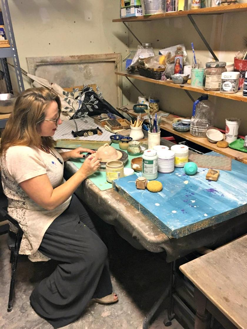 One of the Roebuck Springs potters, Nichole Lariscy Moore, at work in her studio.
