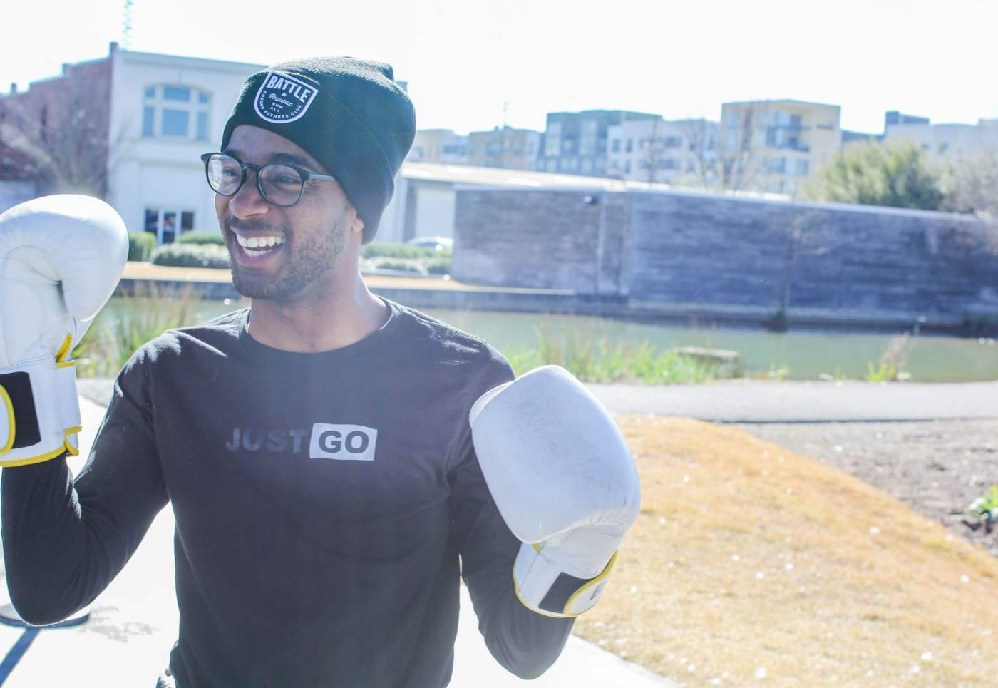 man with boxing gloves and hat
