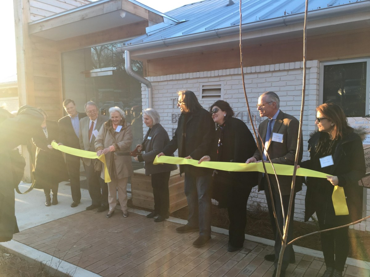 Hand in Paw's ribbon cutting brought smiles and wagging tails to Birmingham yesterday