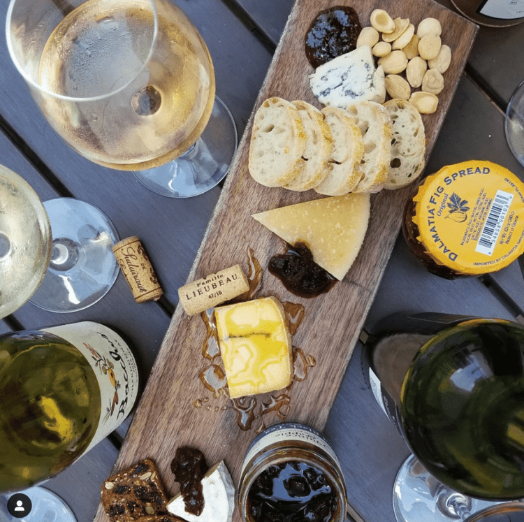 Wine from The Louis and cheese board from Busy Corner Cheese in the Pizitz Foor Hall. (Photo via the Pizitz Food Hall)