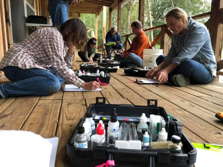 Kim Waites testing water quality with friends.