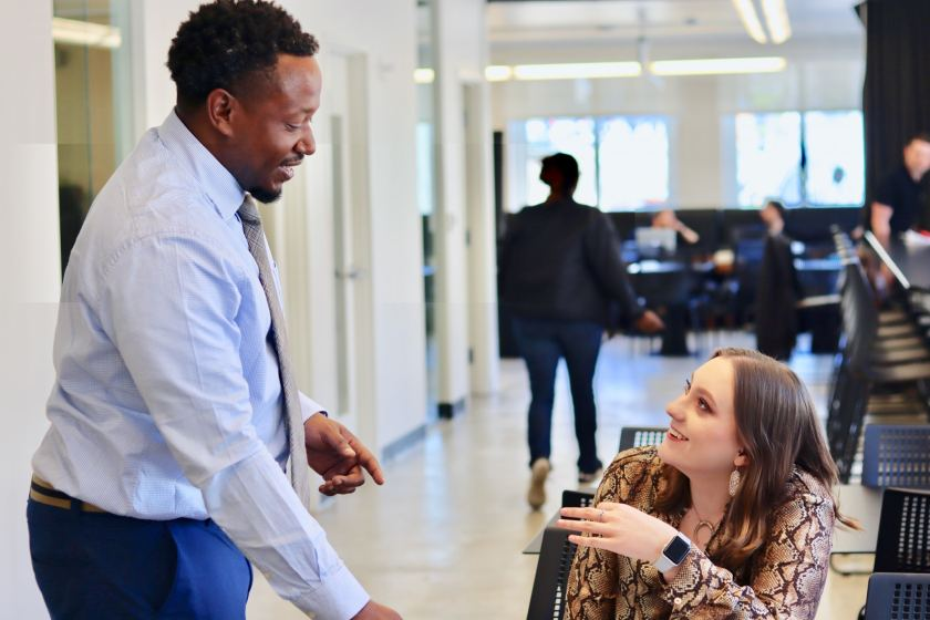 Stanley Stevenson discusses his design work with Bham Now Marketing Coordinator Gabi Hembree. This collaboration between members at Forge is another advantage of working at a co-working space.