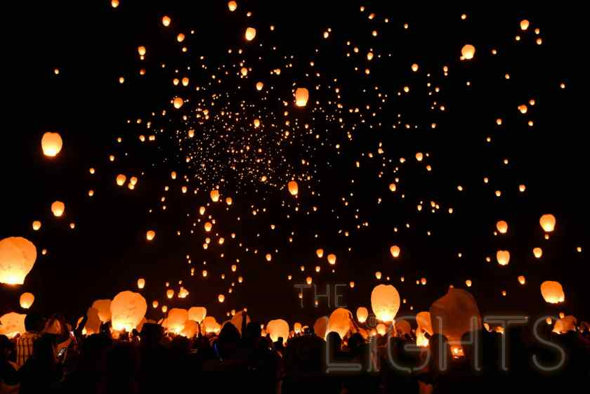 Thousands of lanterns are released into the air in unison with the personal wishes, dreams and goals of festival-goers below written on them. (Photo via The Lights Fest)