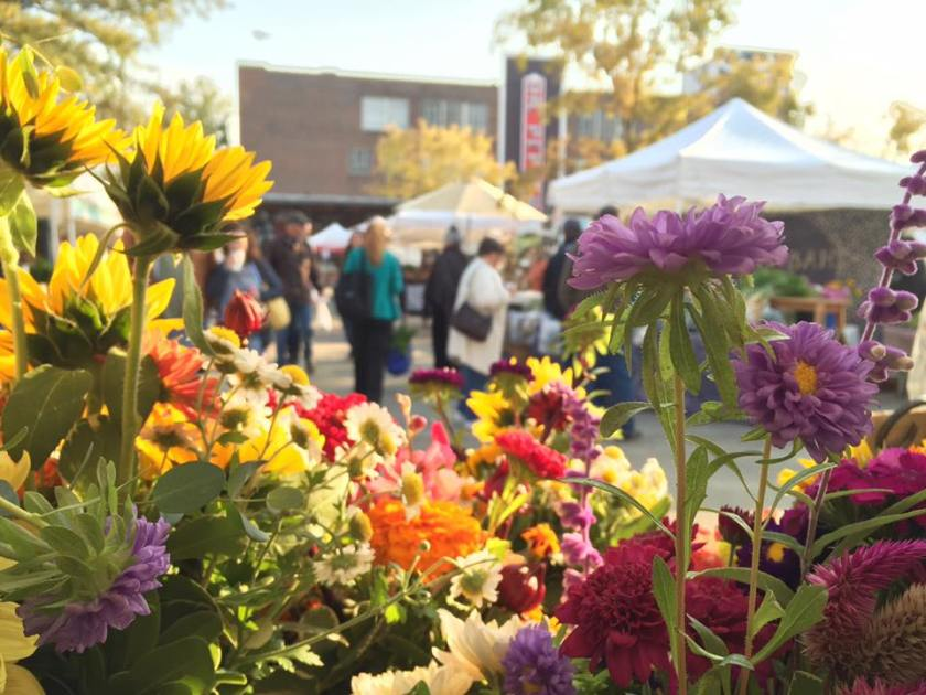 A view of Market at Pepper Place through a bevy of fresh flower bouquets