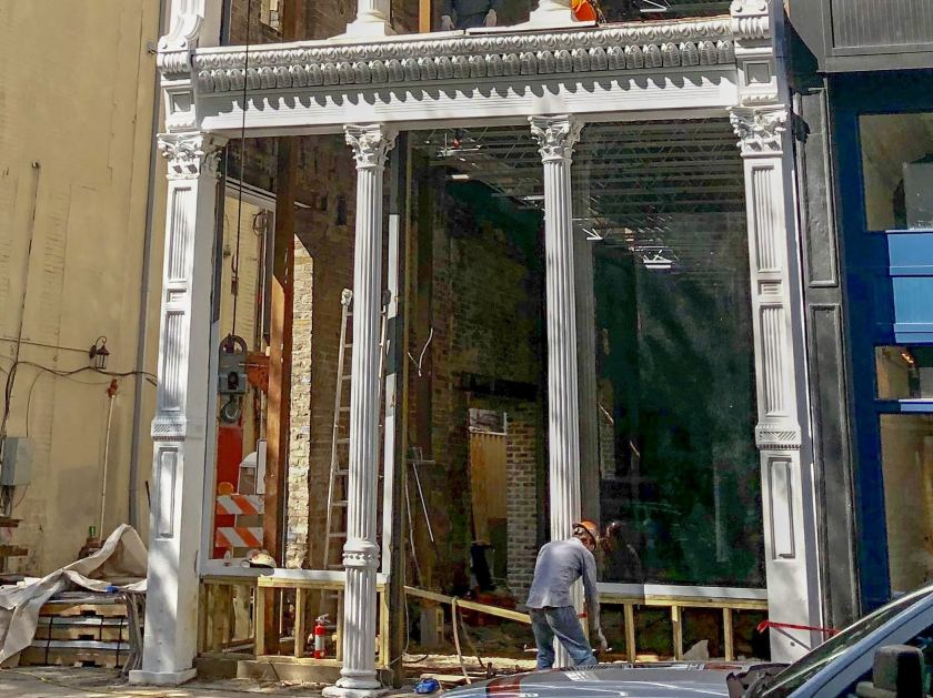 The first impressive window in place at the Iron Building on 20th St North. (Photo by Jon Eastwood for Bham Now)
