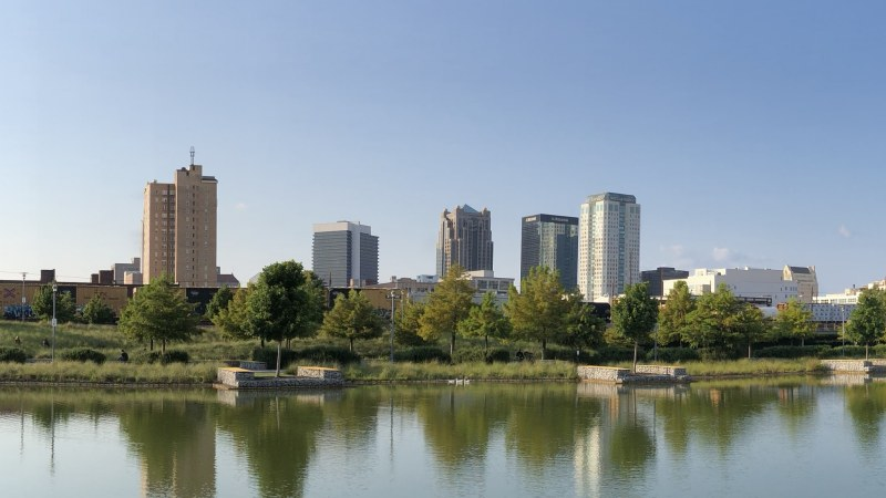 A view of TJ Tower (left) from Railroad Park. Photo by Jon Eastwood for Bham Now.