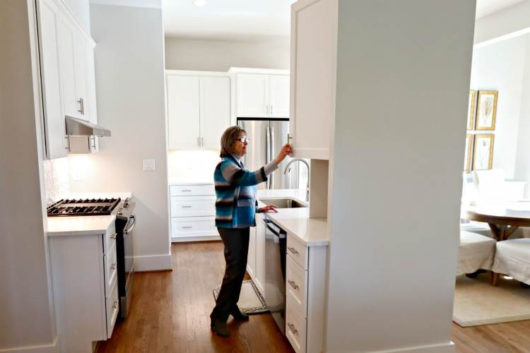 This Cottages on Fifth model features a kitchen that opens into a lovely dining area.