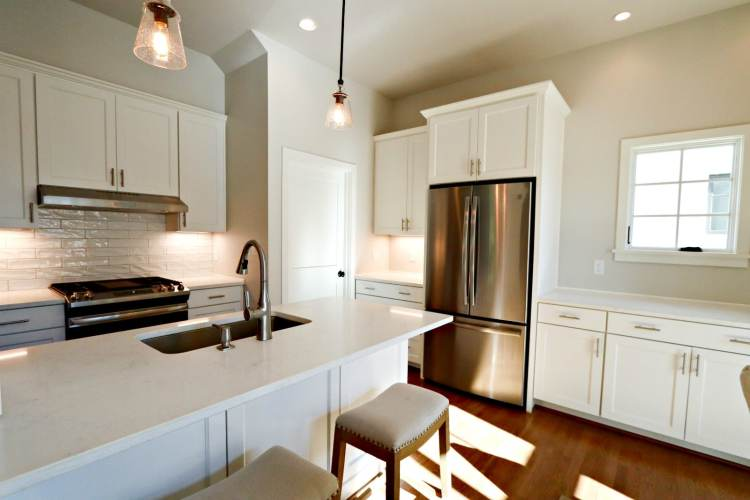 This is another view of the kitchen area at Cottages on Fifth, showing the island in the middle.