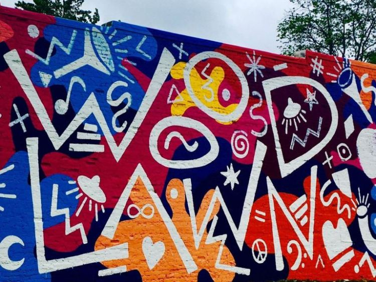 The mural on the side of the Cyclorama in Woodlawn is a sign of the area's vibrancy.