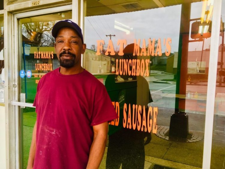 At Woodlawn's Fat Mama's Lunchbox, you can get good for for a super-low price. Reggie Cook stands in front of the restaurant.