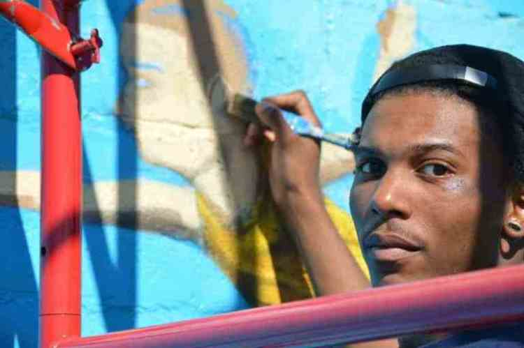 "Thurston Hamby is one of three artists from Blank Space Bham who painted ""The Sky's the Limit,"" a new-ish mural in Woodlawn."