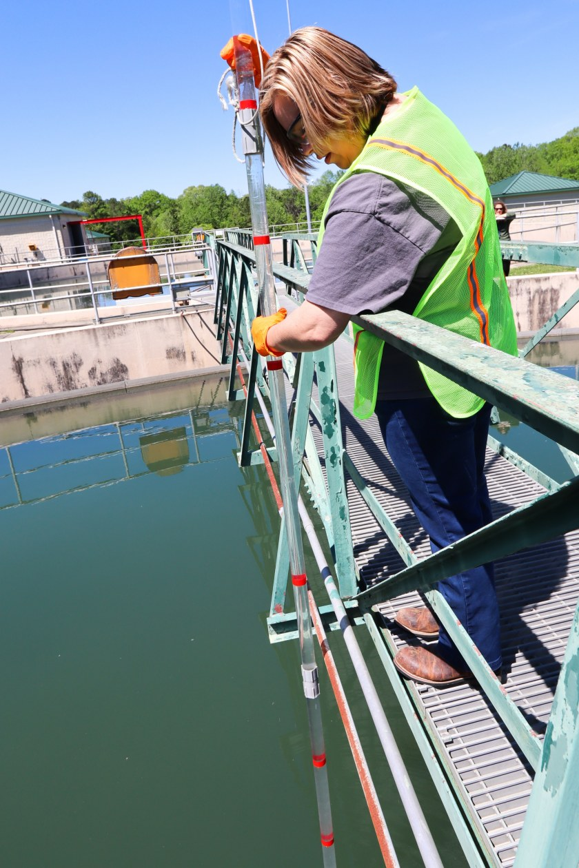 White at the Leeds location checking levels of solid materials that have settled to the bottom of a clarifier. Photo by Christine Hull for Bham Now