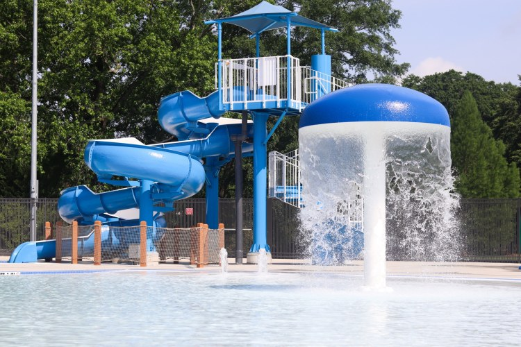The slide and waterfall at the new Patriot Park Aquatic Center. (Photo by Christine Hull for Bham Now)