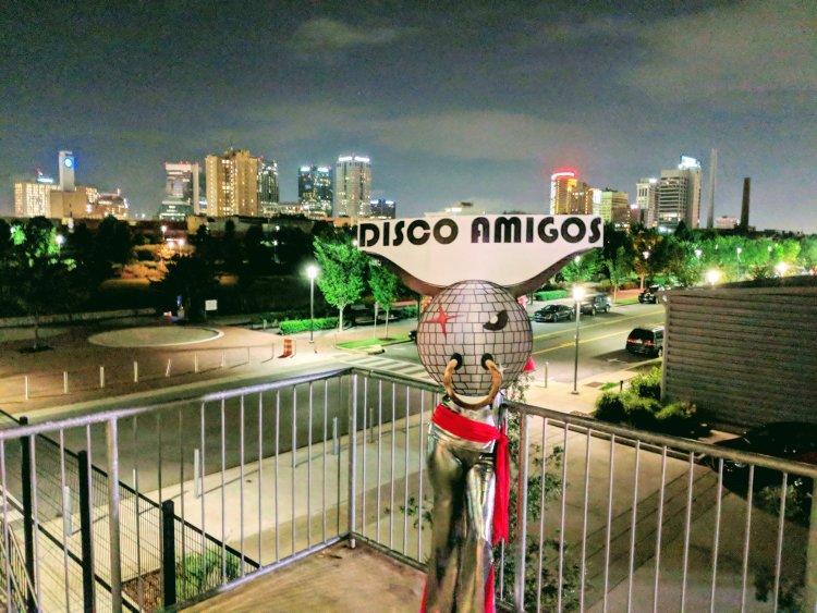 Disco Amigos mascot overlooking Railroad Park.