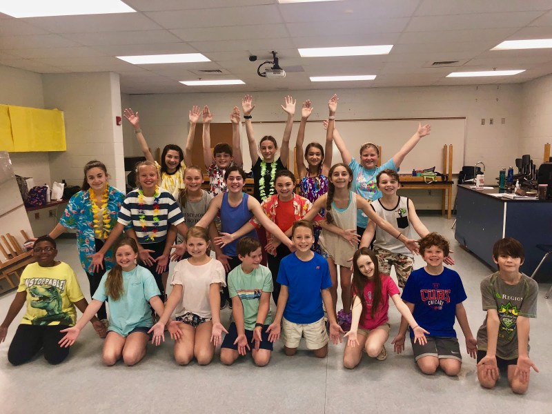 Young cast of Matilda The Musical smile for the camera during Matilda Bootcamp