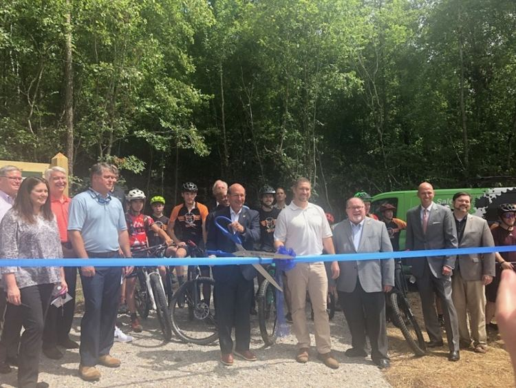 Cutting of the ribbon at Black Creek Mountain Bike Park by Hoover Mayor Frank Borato