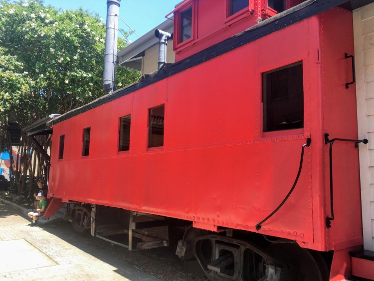 The little red caboose on Morris Ave. is now home to Kinetic Communications.