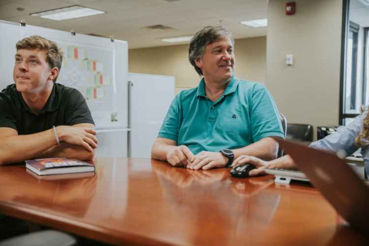 EBSCO Industries employees in boardroom. Birmingham, Alabama.