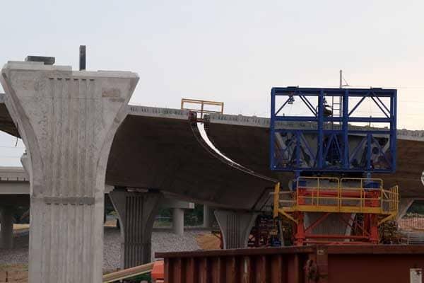 The 59/20 bridge project photos include curves before the concrete pour.