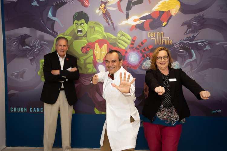The CerFlux team striking their best superhero poses.