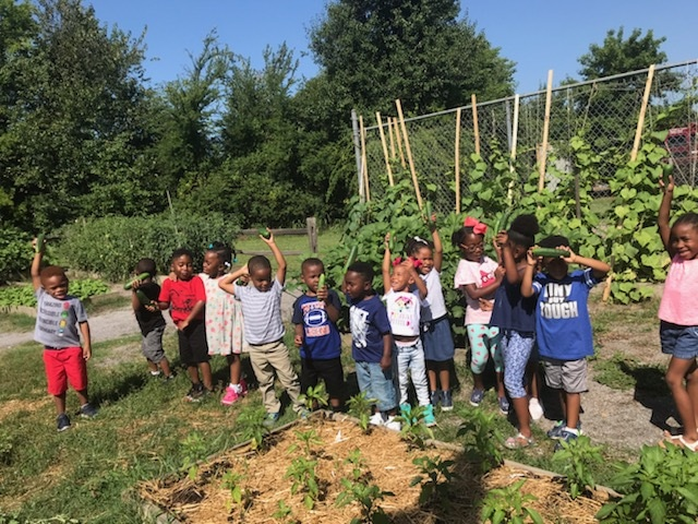 Summer campers in the garden at Greater Shiloh Missionary Baptist Church in the Jones Valley Neighborhood of Birmingham.