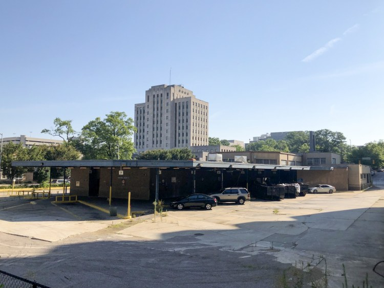 A parking lot for buses means a large lot for people who will work in the old Greyhound Station.