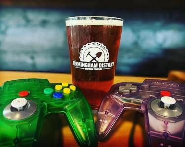 New Birmingham Beer called Birmingham Tea Party by Birmingham District Brewing, next to two Nintendo 64 controllers