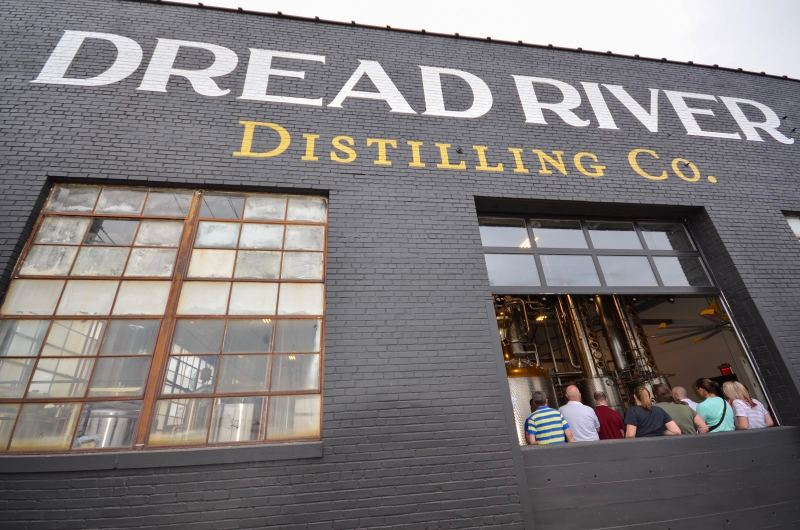 Outside wall featuring Dread River Distilling Co. signage