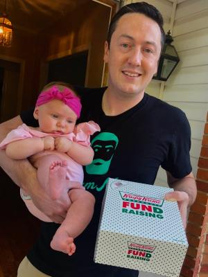 Man and baby with doughnuts