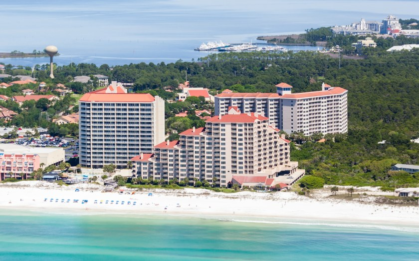 Hotel and white sandy beach. ResortQuest vacation destination
