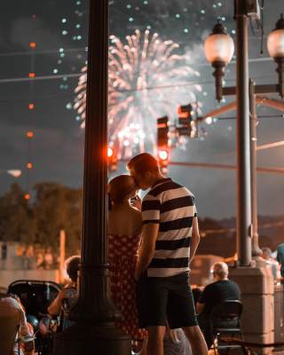 Couple kiss under fireworks