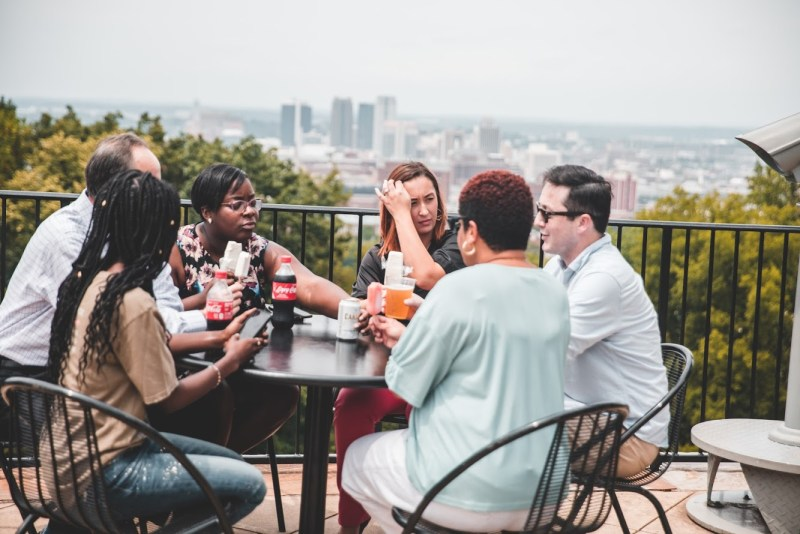 Friends socializing at Vulcan Park and Museum, Birmingham, Alabama with snacks , drinks and beverages from new kiosk
