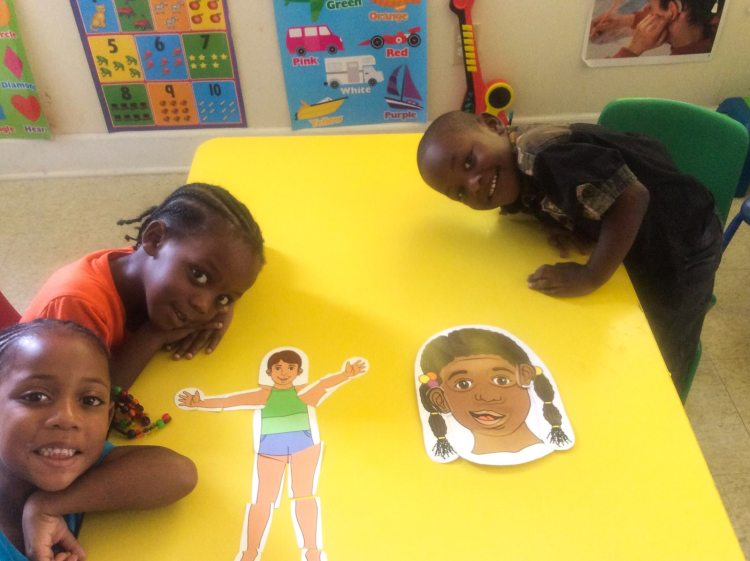 Kids Smiling with Art Project