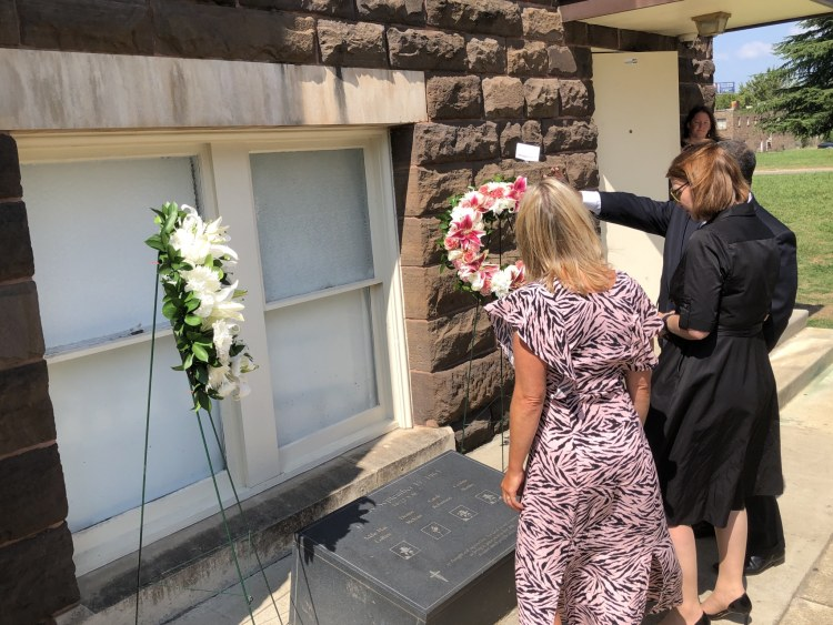 Wreaths being laid outside the 16th Street Baptist Church. Pastor Arthur Price, Jr. shows Welsh delegation the Wales Window at 16th St. Baptist Church. Kirsty WilliamsWelsh Minister for Education and Sian Lewis CEO of The Urdd