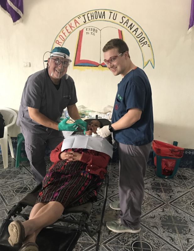 Dr. Pruitt abroad performing a dental procedure