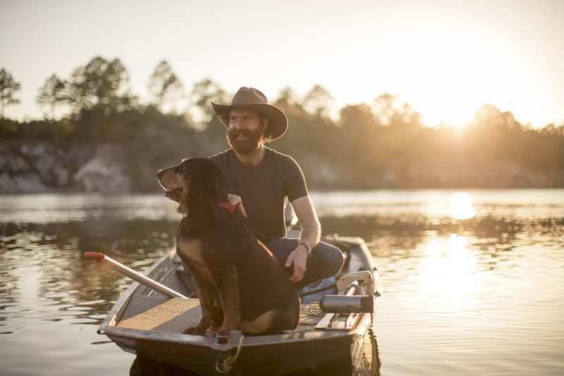 Man and Dog in Boat