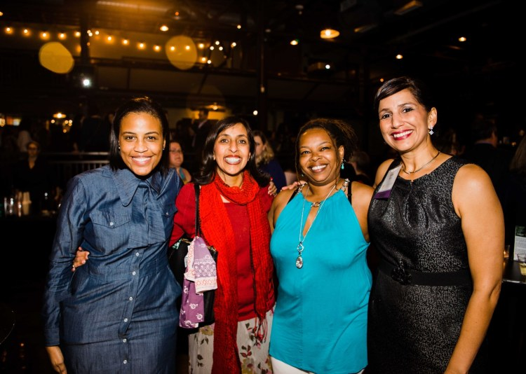 Four women smile and pose together at Smart Party 2018.