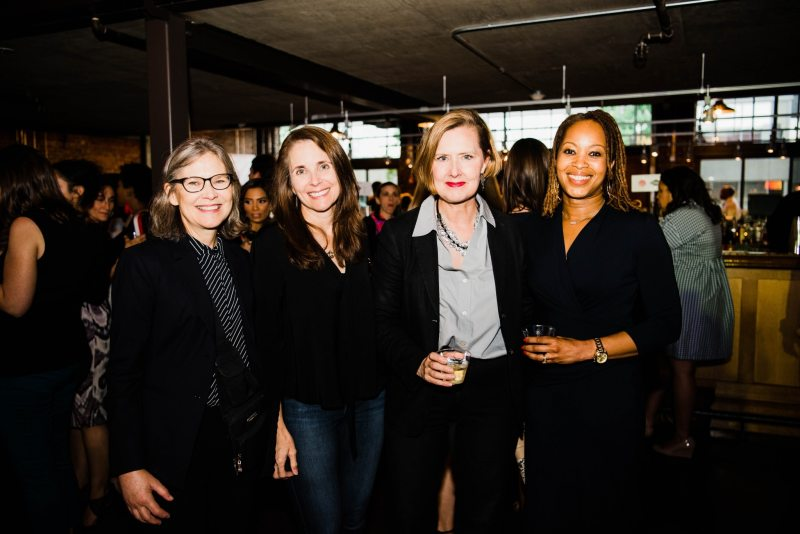 A group of four women pose and smile together at Smart Party 2018.