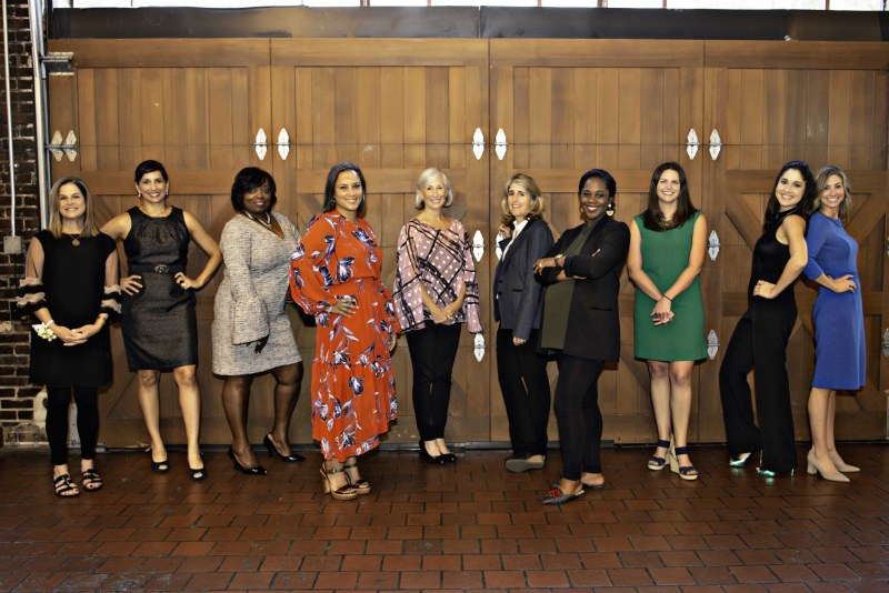 The Smart Honorees of 2018 stand in a line. Each one holds a different pose while smiling.