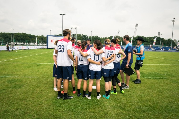 The US flying disc team is huddle together before a game