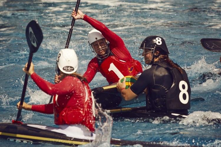 Women's canoe polo teams at play