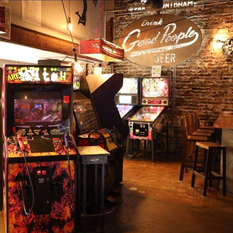 pinball and arcade games in a bar