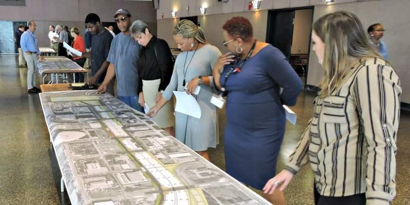 People looking at renderings for CityWalk BHAM