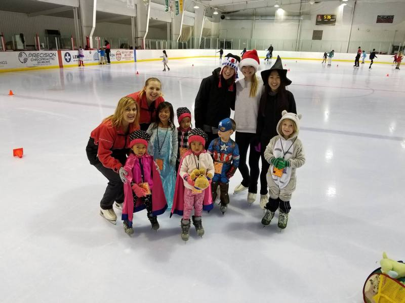 Kids dressed in costumes on the ice rink