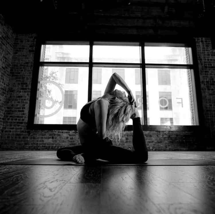 Girl stretches on floor