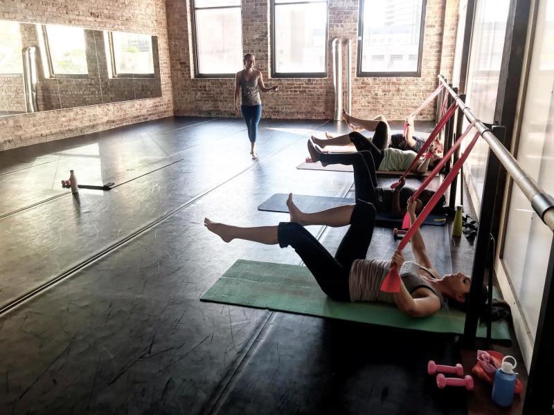 Girls exercise on an aerobics mat