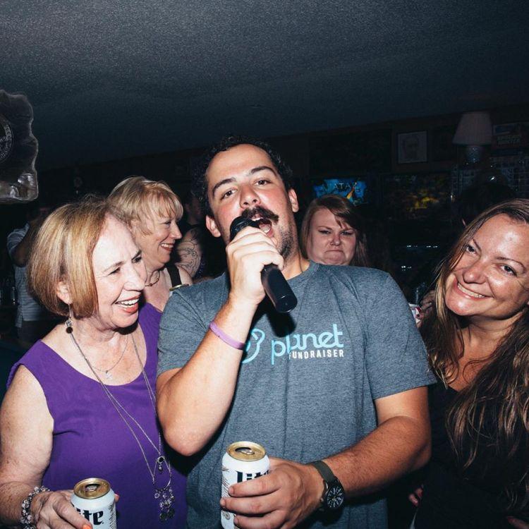 A man sings at a Birmingham karaoke spot.