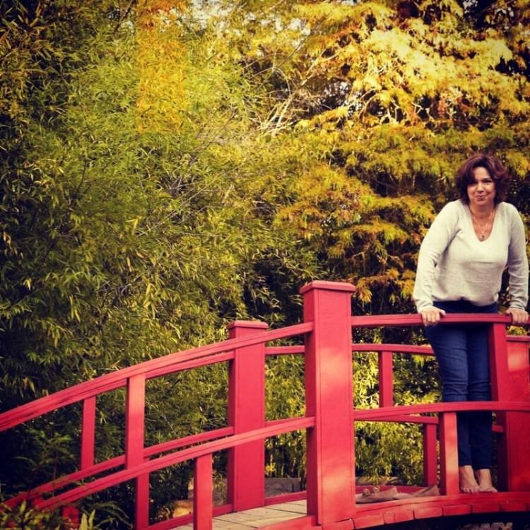 Woman poses on bridge