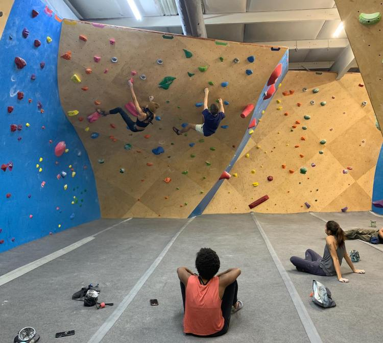 People climb on a rock wall