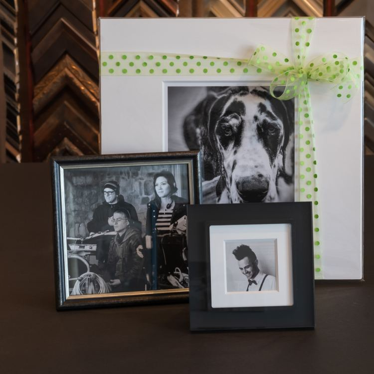 More easel back and table top photos. One picture depicts a Great Dane dog.